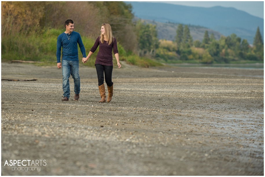 07 Kamloops engagement photographer couple walking on the beach