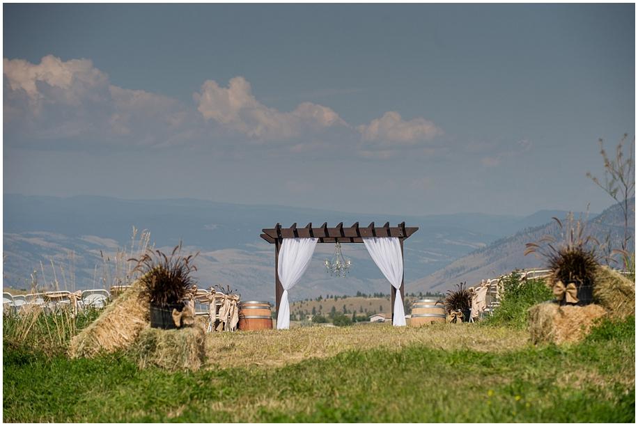 Kamloops wedding photographer  outdoor summer ceremony chandelier arbour valley view mountian top