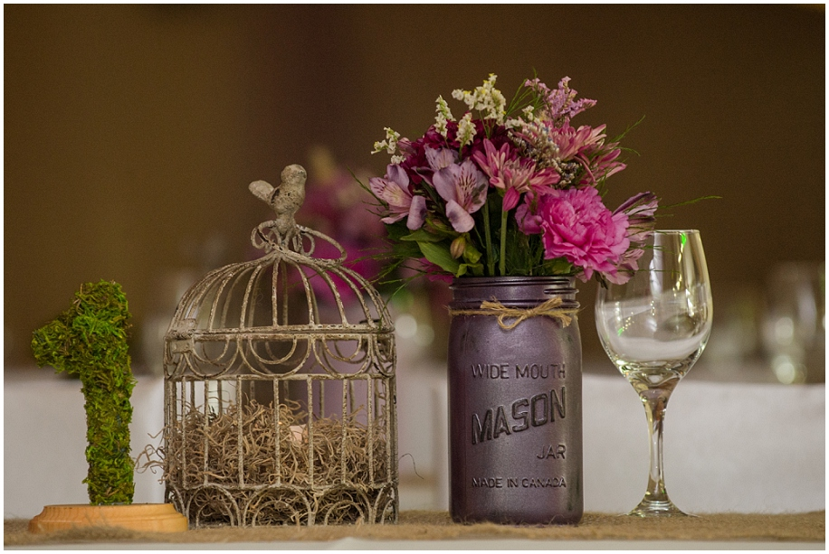 Barriere Wedding photographer detail shots reception birdcage mason jars florals