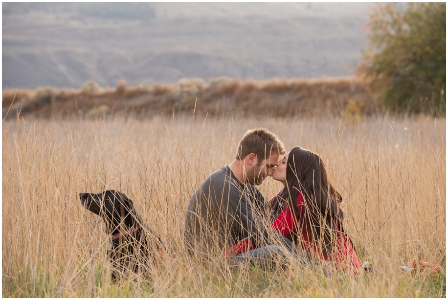 BC engagement photographer romance in a grassy field with the dog fur baby