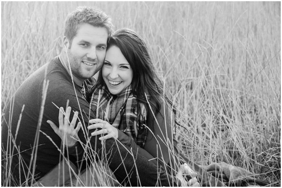 Kamloops BC outdoor engagement photography black and white cuddle in the grass field