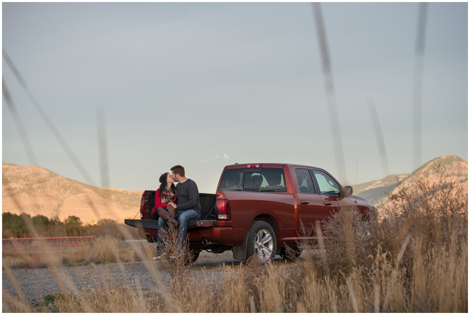 Kamloops Lake engagement session at sunset with the grooms truck tailgate kiss