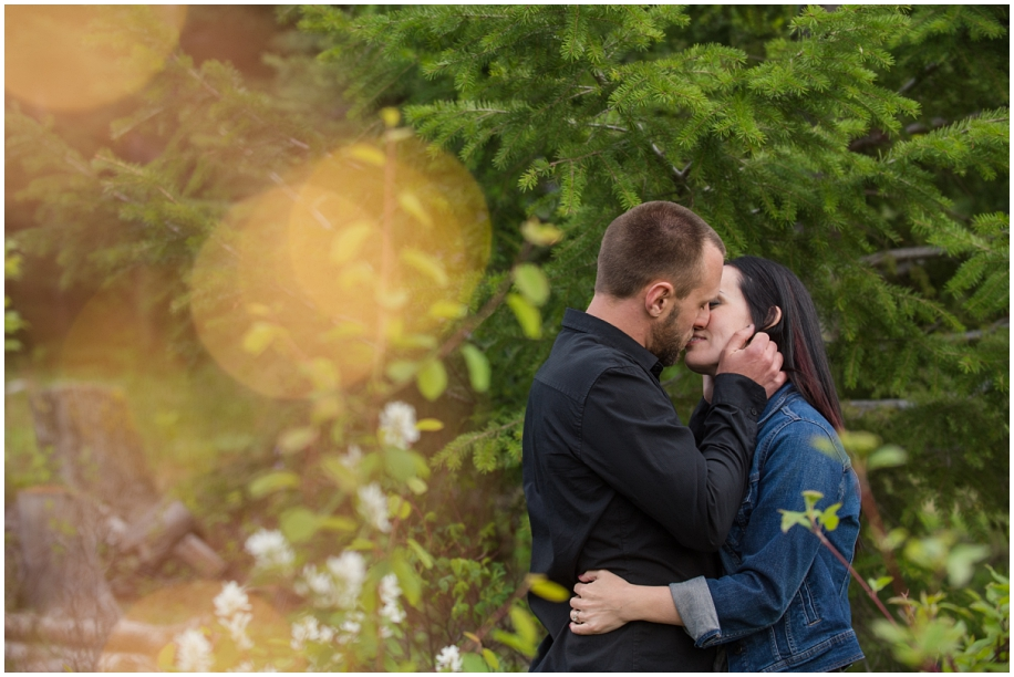 Kamloops wedding photographer Harper Mountain engagement session spring flowers bokeh kiss