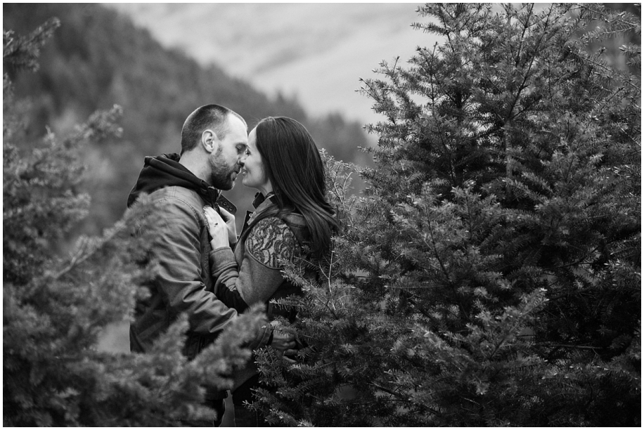 Kamloops wedding photographer Harper Mountain engagement session black and white romantic kiss shot in the forest