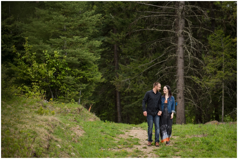 Kamloops wedding photographer Harper Mountain engagement session bride and groom walking forest path