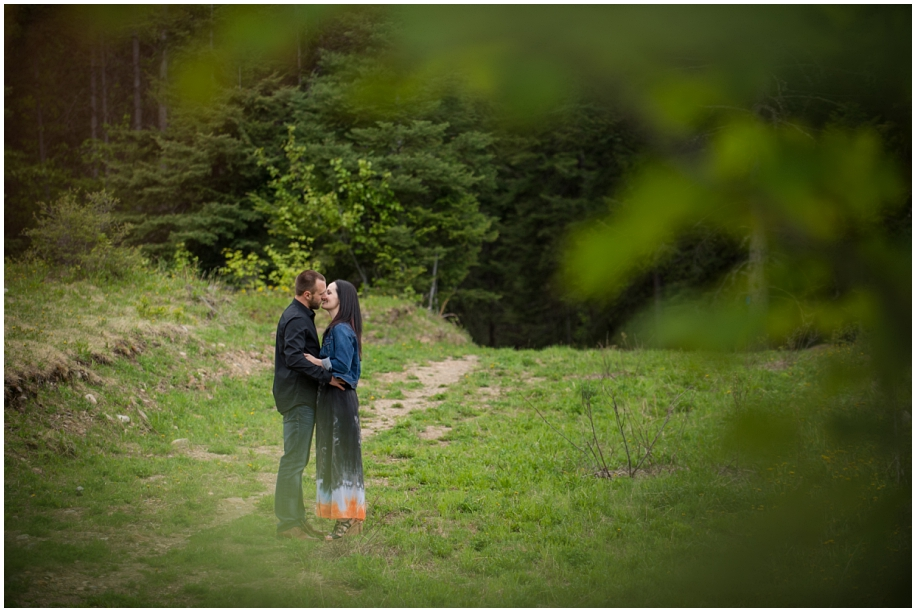 Kamloops wedding photographer Harper Mountain engagement session bride groom kissing forest path