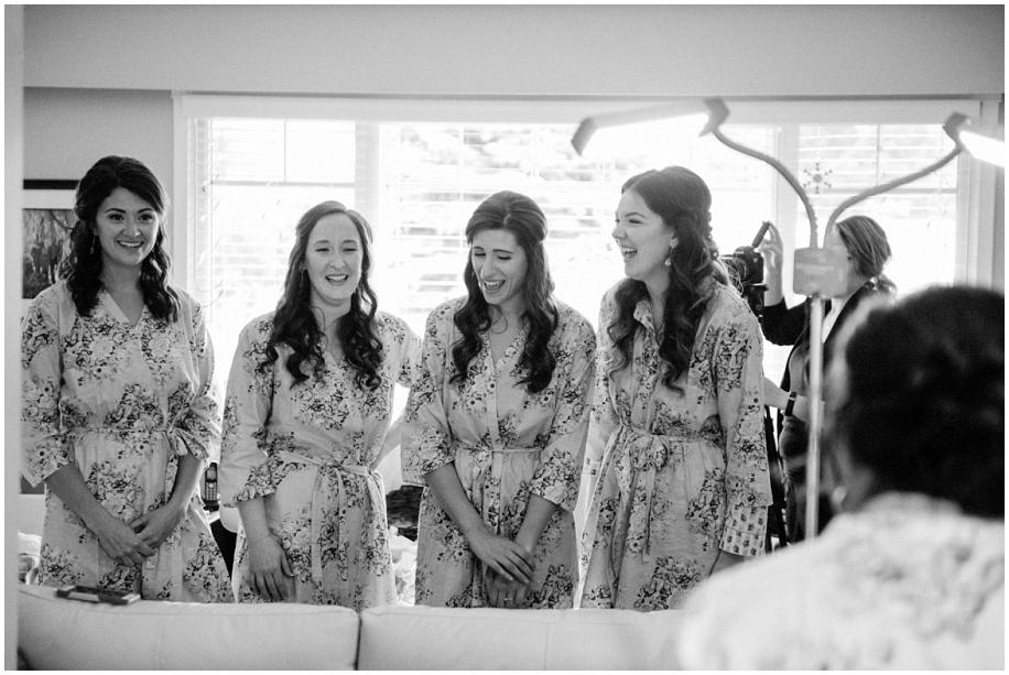 Kamloops documentary wedding photographer bride preparations makeup black white bridesmaids
