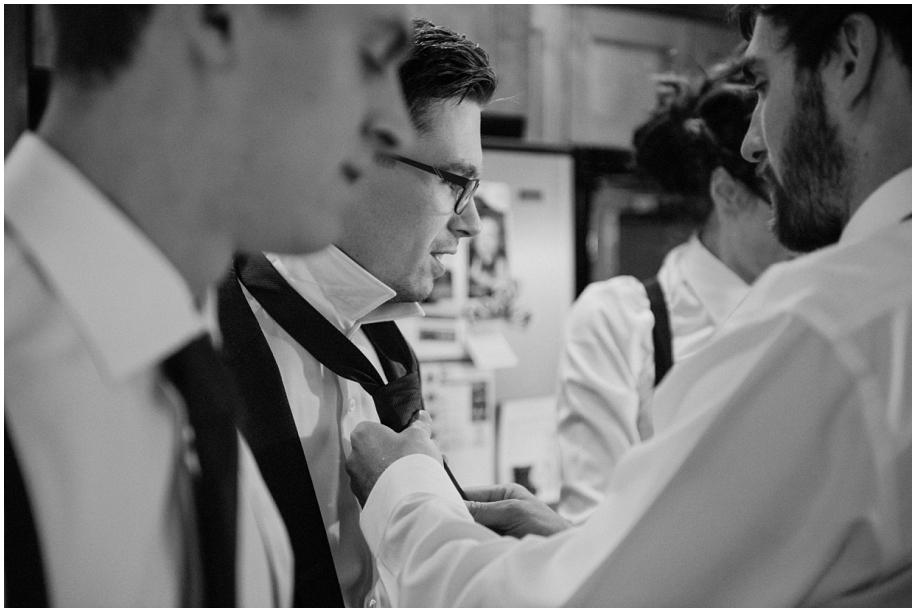 Kamloops documentary wedding photographer groom preparations makeup black white