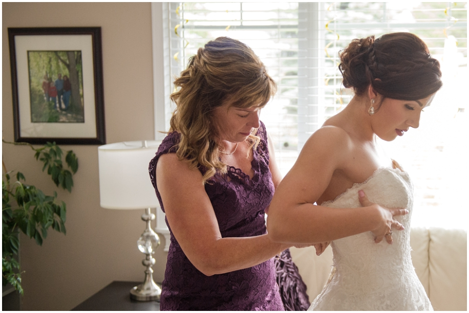 British Columbia wedding photographer bride preparations dress window light