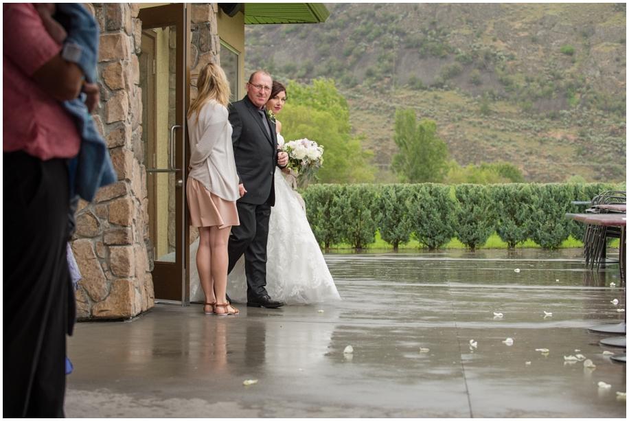 BC Interior wedding The Dunes Kamloops ceremony rain bride father