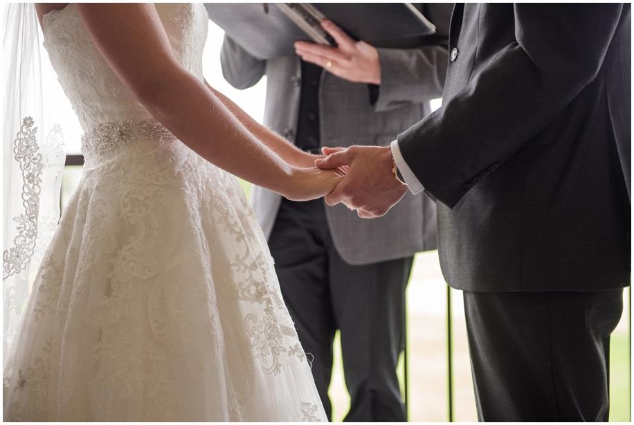 BC Interior wedding photographer The Dunes Kamloops ceremony rain holding hands
