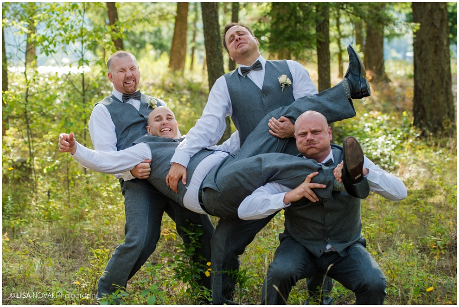 Outdoor Shuswap Lake Summer wedding Quaaout Lodge fun groomsmen pose idea peach gray bowtie