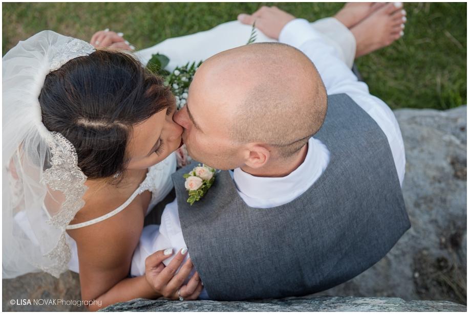Beautiful Shuswap Lake wedding stolen moment kiss golf course