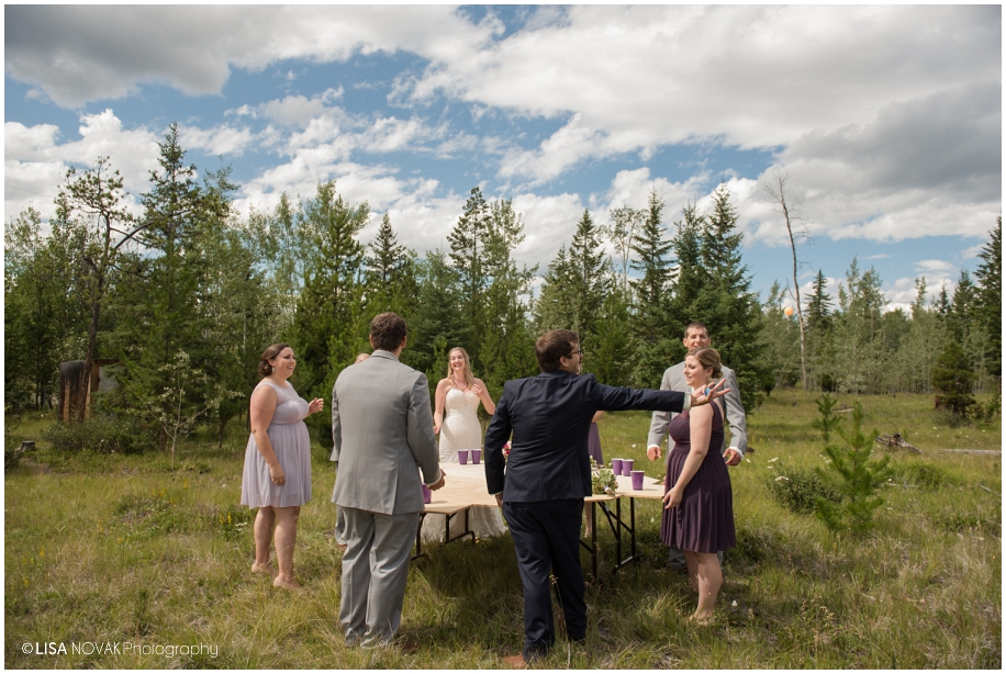 Forest wedding beer pong - Big Bar Lake BC photographer Lisa Novak