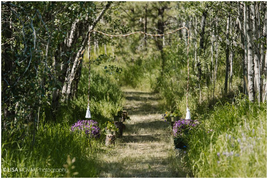 ceremony pathway forest flowers BC interior outdoor Shuswap Corbett Lake Lodge ceremony location