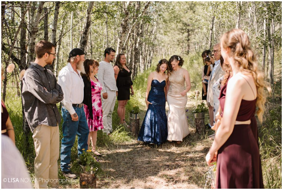 BC interior outdoor Okanagan wedding photographer beautiful bride lesbian summer ceremony intimate forest