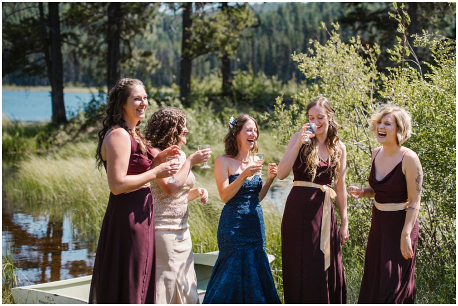 BC Okanagan summer wedding brides bridesmaids lakeside forest rowboat canoe same sex champagne toast laughter