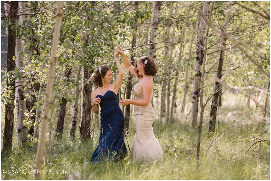 BC Nicola Valley summer wedding old fence bridal portraits pose same sex Canada ranchand mountains first dance