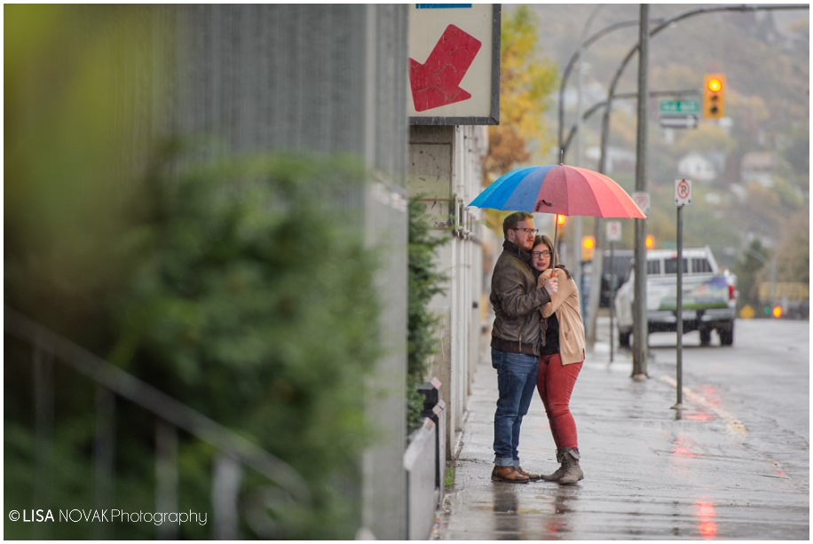 BC autumn engagement session rain rainy day urban downtown Red Collar Brewing umbrella
