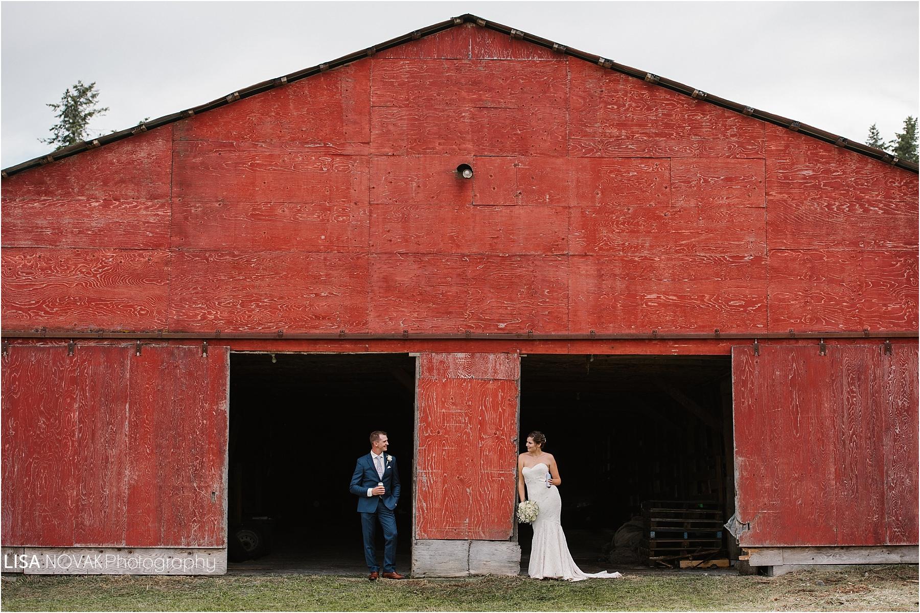 Okanagan wedding photographer BC Interior bride groom romantic epic mountain bridal portraits red barn drinks blue tux