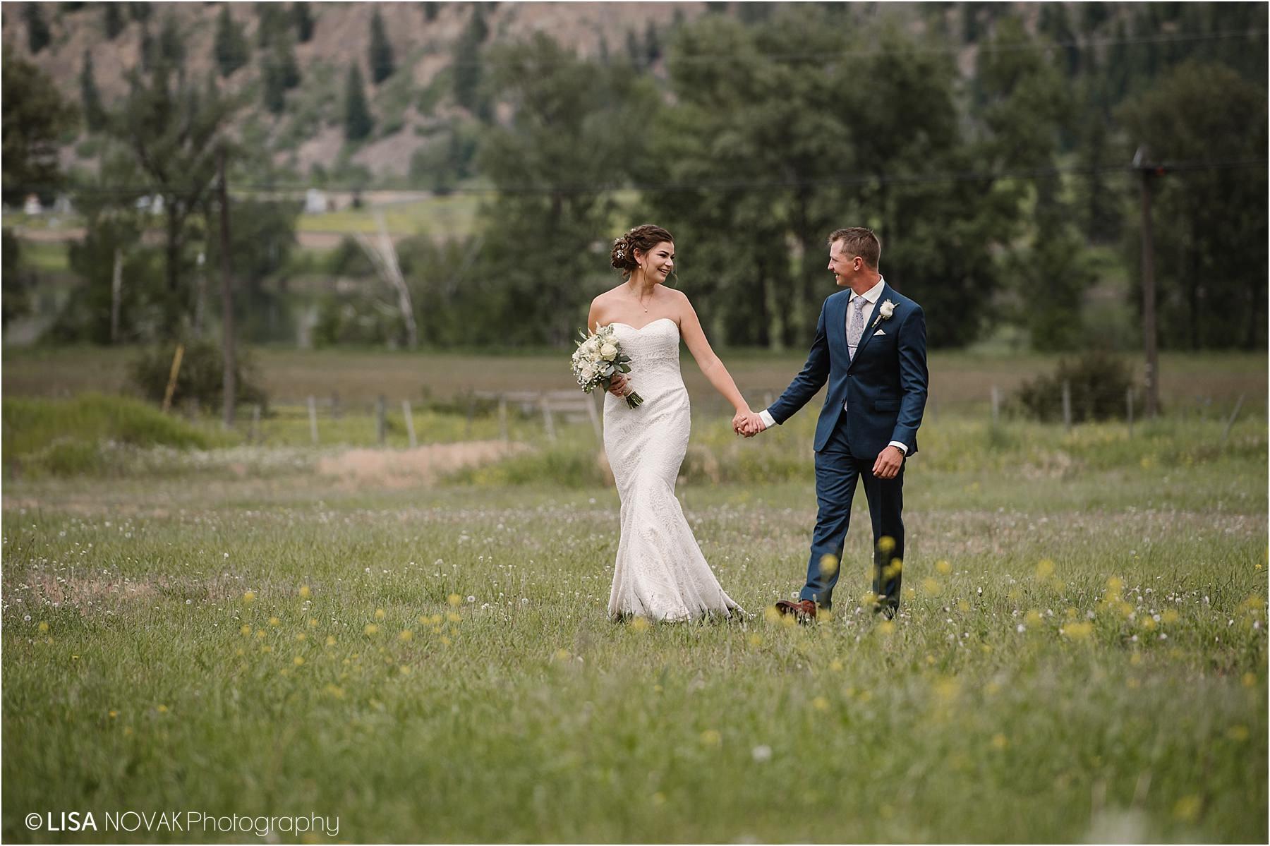 Okanagan wedding photographer field flowers view bride groom romantic epic mountain bridal portraits Barriere blue tux style