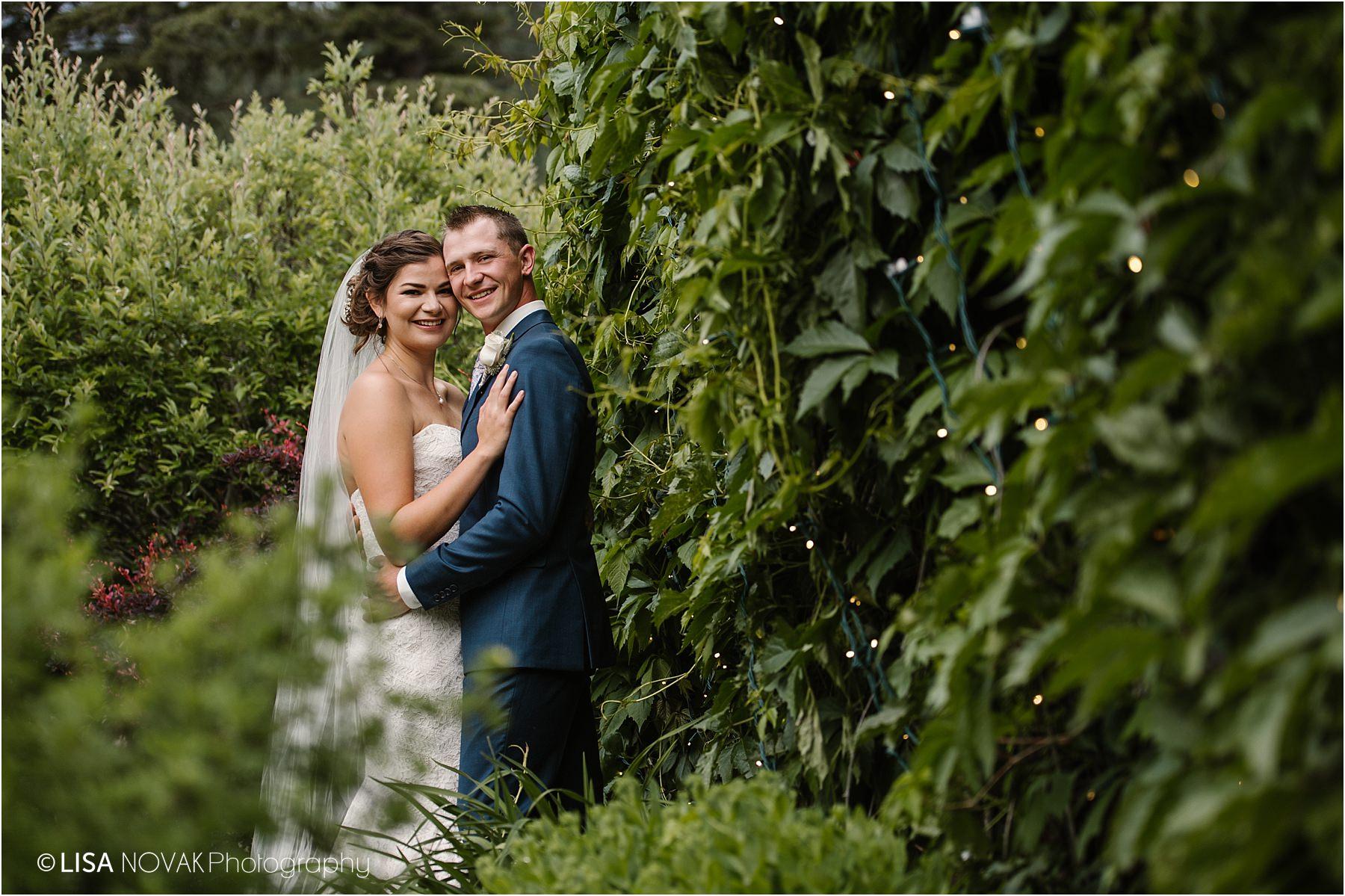 Okanagan wedding photographer BC Interior bride groom romantic epic garden bridal portraits first look twinkle lights