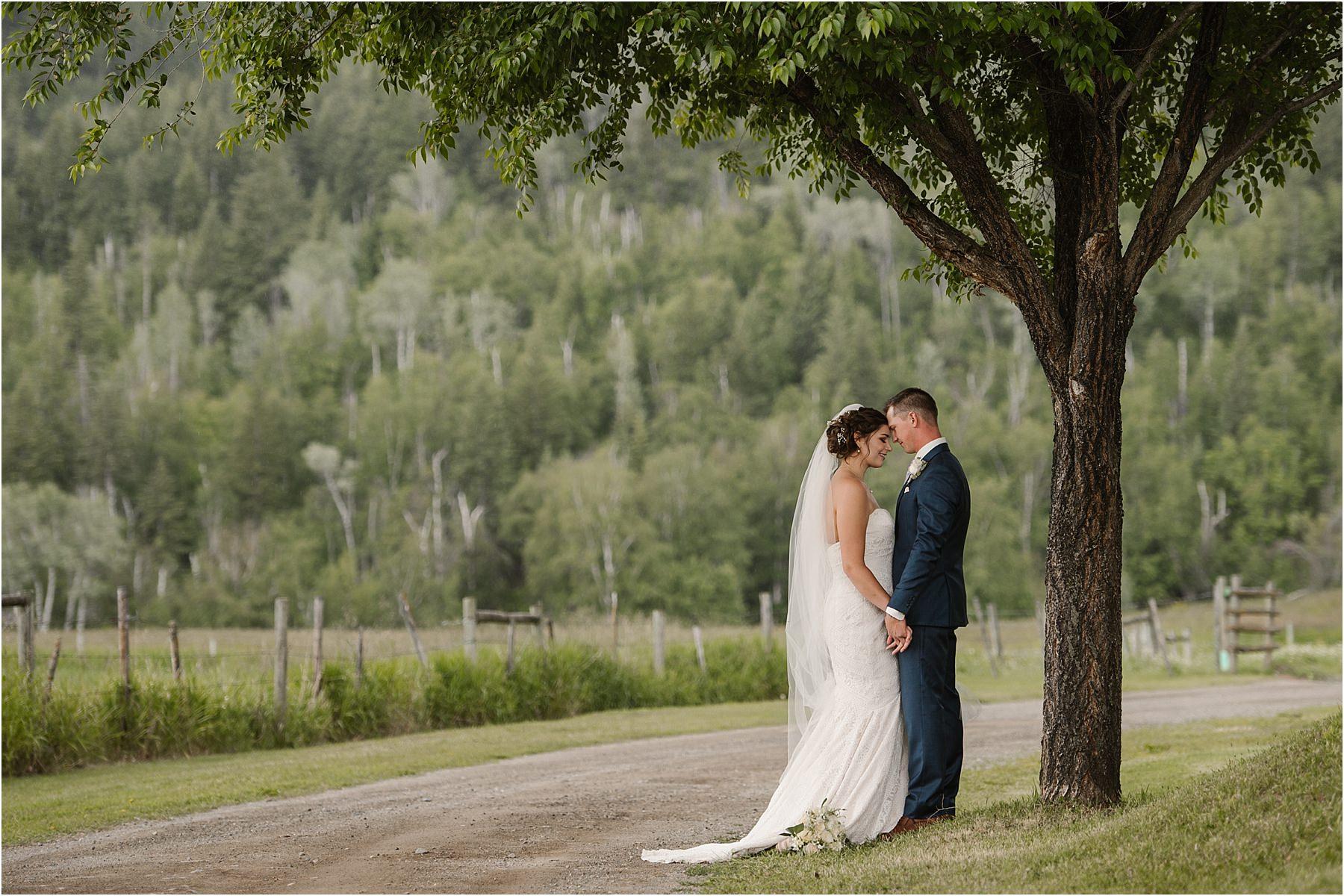 Kamloops wedding photographer quiet moment bridal portrait bride and groom rainy wedding romance blue tux