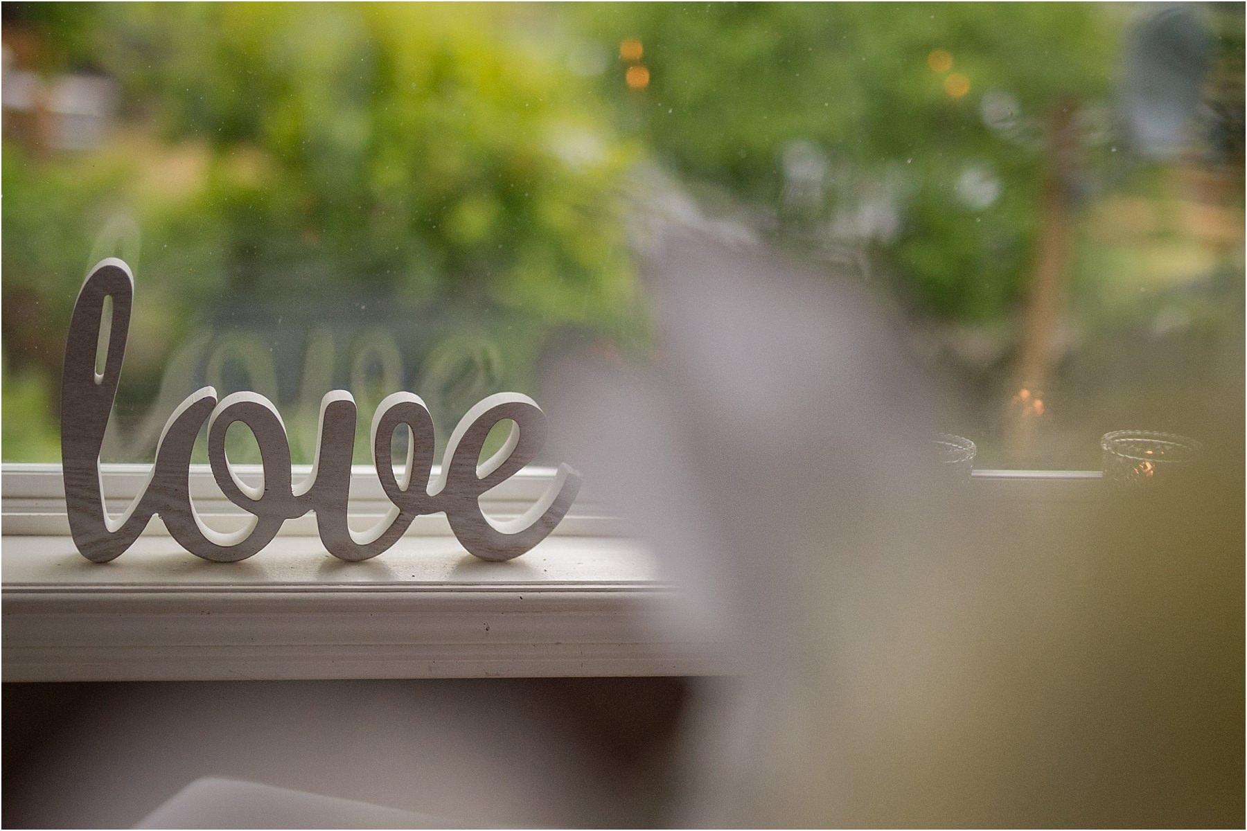 Kamloops wedding photographer details detail shot reception venue ideas love wood cutout script candles