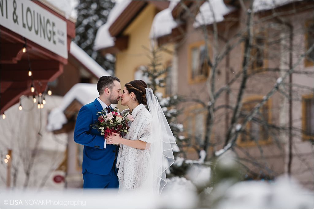 Destination winter wedding Sun Peaks bride groom kiss romance snow