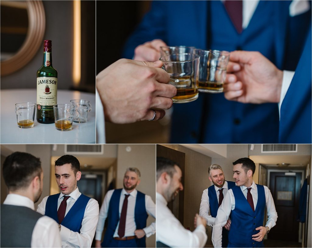 Destination winter wedding groomsmen preparations blue tux Jameson whiskey toast