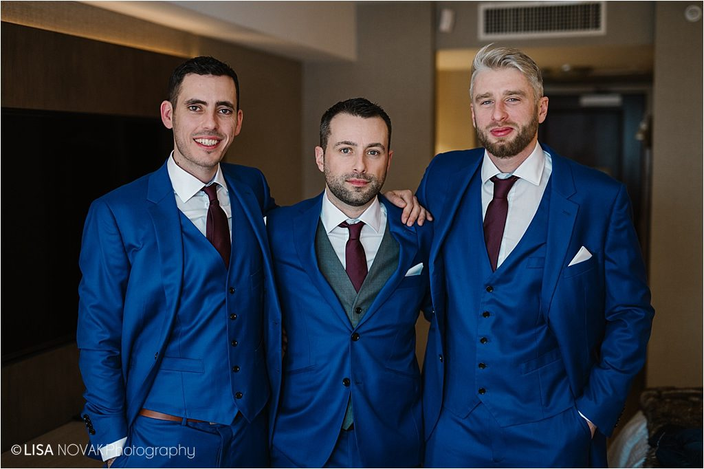 Destination winter wedding Sun Peaks Grand groom groomsmen blue tuxes portrait