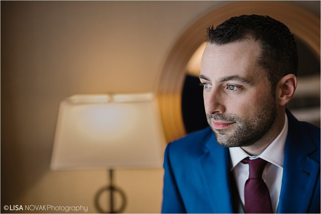 Destination winter wedding groom portrait blue tux ski resort