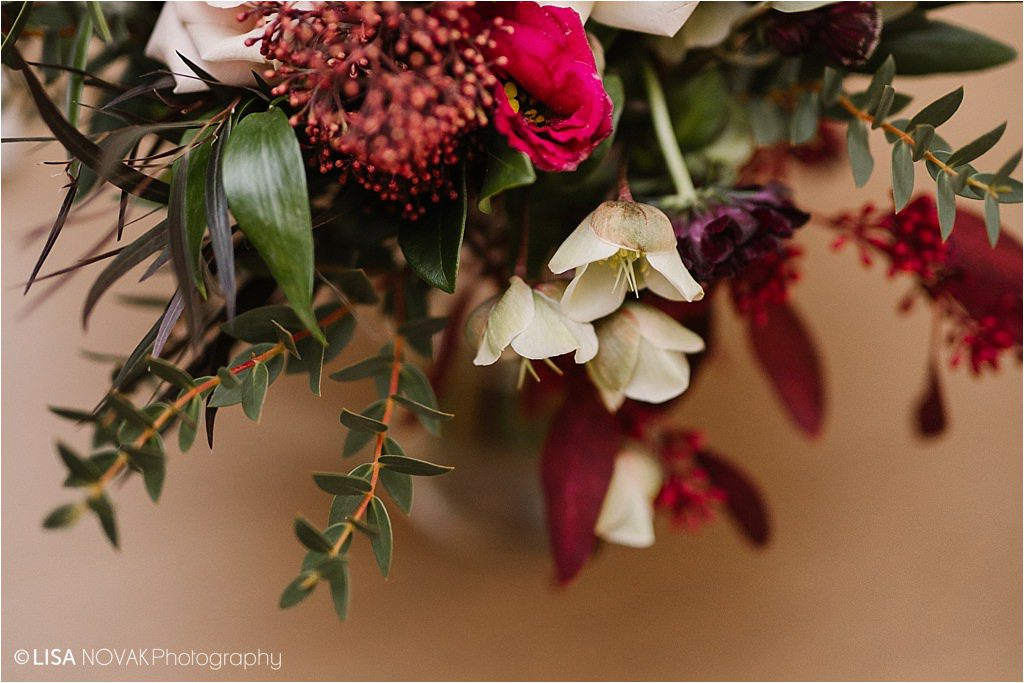 Destination winter wedding Canada detail shot bouquet burgundy and white greenery luxe florals