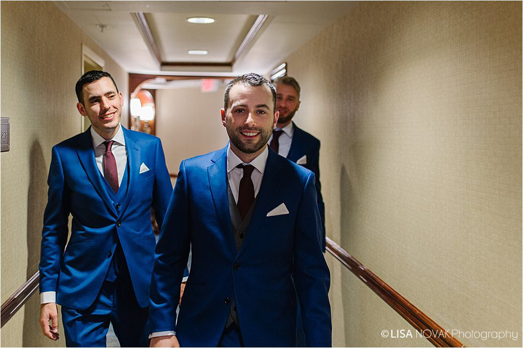 Destination winter wedding Sun Peaks Grand groom groomsmen reservoir dogs shot
