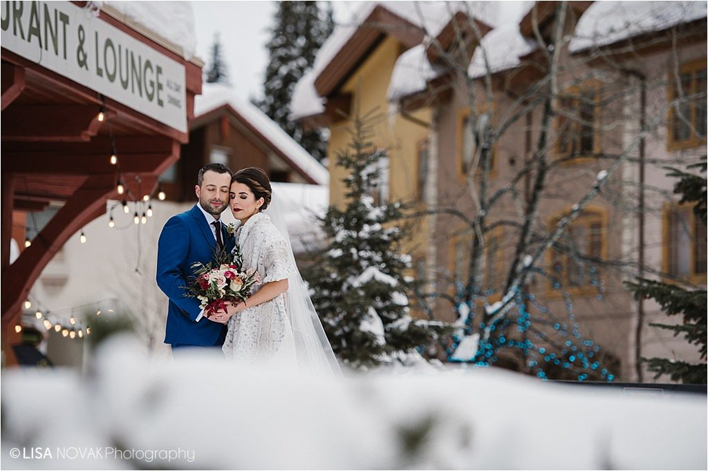 Destination winter wedding Sun Peaks Grand wedding bridal portrait bride groom outdoors snowy