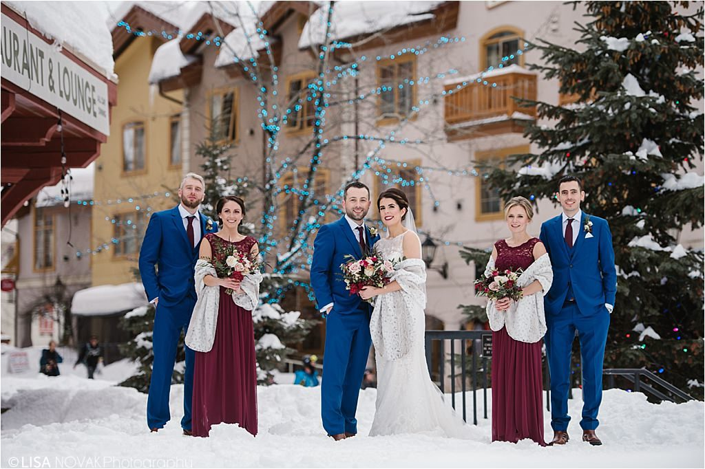 Destination winter wedding Sun Peaks Resort bridal party pose ideas blue burgundy snowy