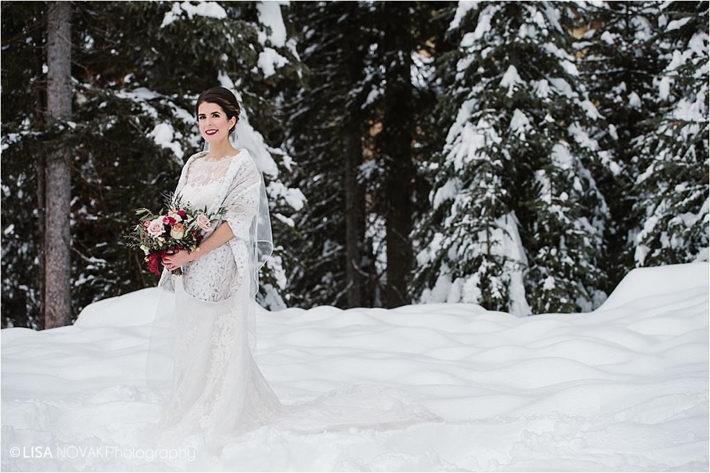 Sun Peaks Resort winter Irish wedding destination bridal portrait beautiful bride Looks by Laine makeup artist lace gown bouquet Brandy Maddison