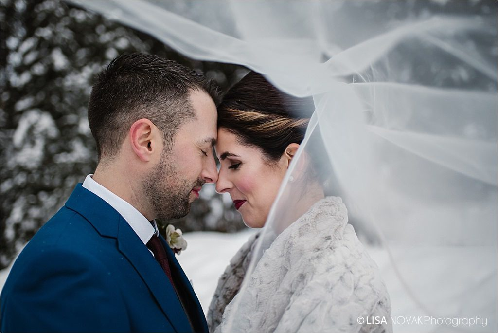 Canadian winter destination wedding bride groom blue burgundy cathedral veil portrait romance forest
