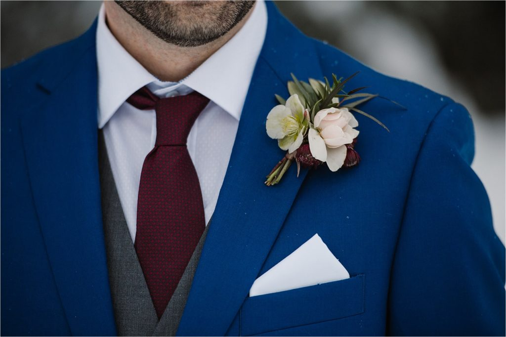 Canadian winter destination wedding bride groom blue burgundy detail shot boutonniere florals Brandy Maddison Events