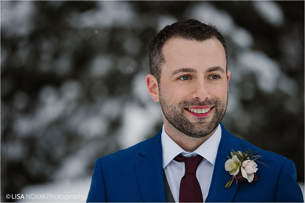 Canadian winter destination wedding groom portrait blue burgundy detail shot boutonniere florals Brandy Maddison Events
