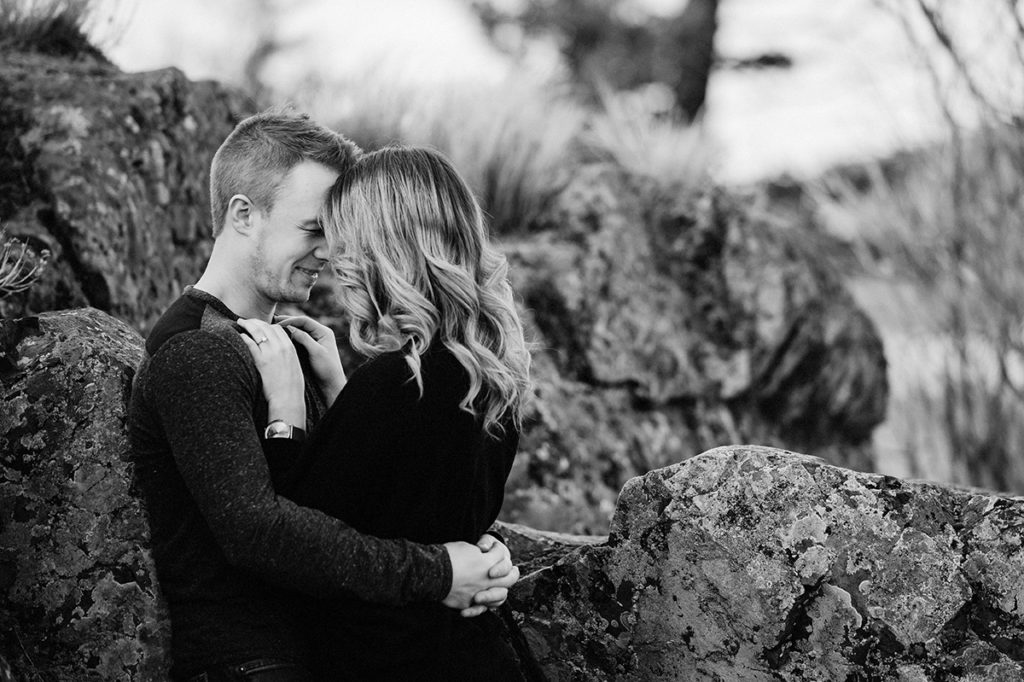 Kamloops okanagan portrait photographer romantic outdoor couple session engagement mountains lake view black and white