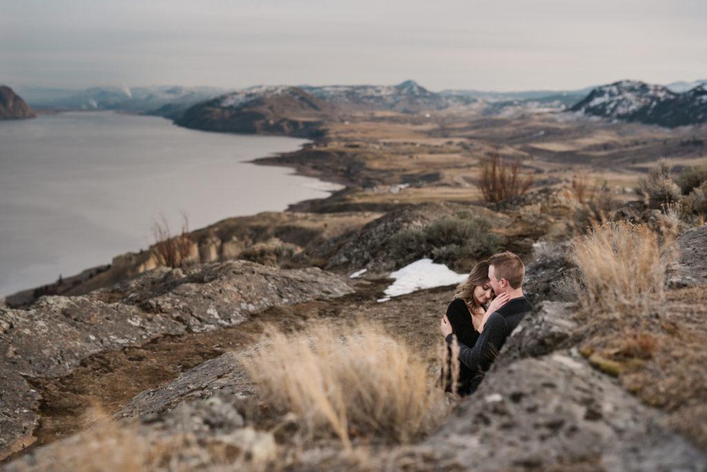 Kamloops okanagan portrait photographer romantic outdoor couple session engagement mountains lake view