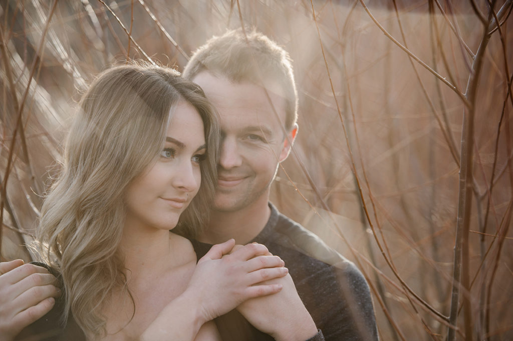 Kamloops okanagan portrait photographer romantic outdoor couple session engagement backlit golden hour romance