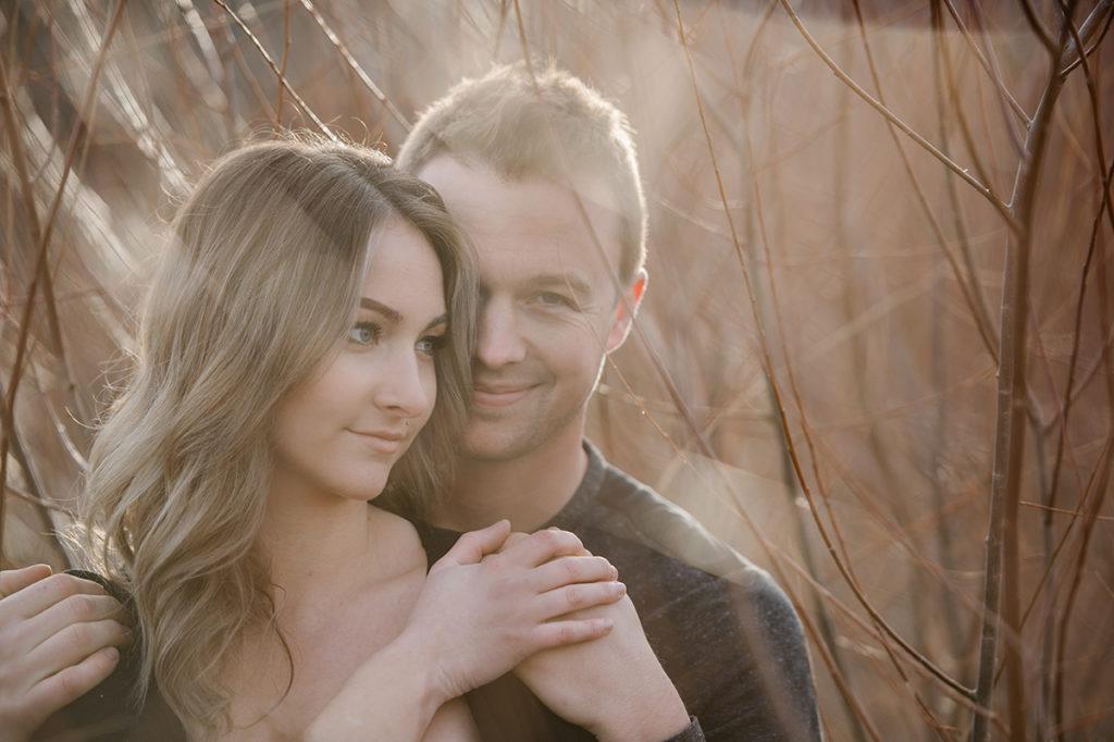 Kamloops okanagan portrait photographer romantic outdoor couple session engagement backlit golden hour romance