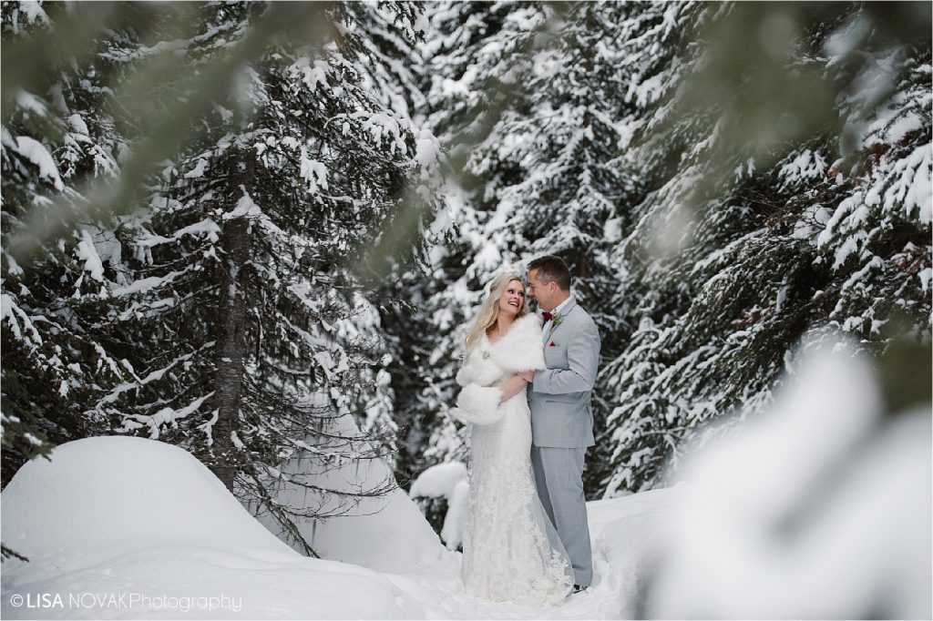 Winter wedding Bride and Groom portrait in the forest at Sun Peaks Resort