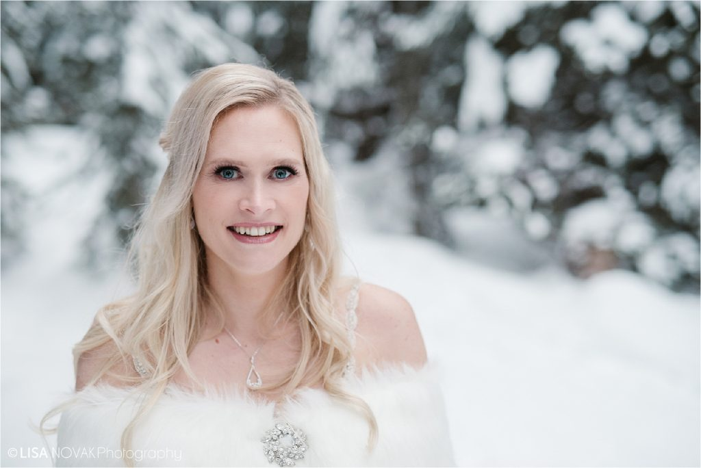 Beautiful bridal portrait at a winter wedding in the mountains of Canada at Sun Peaks Ski Resort