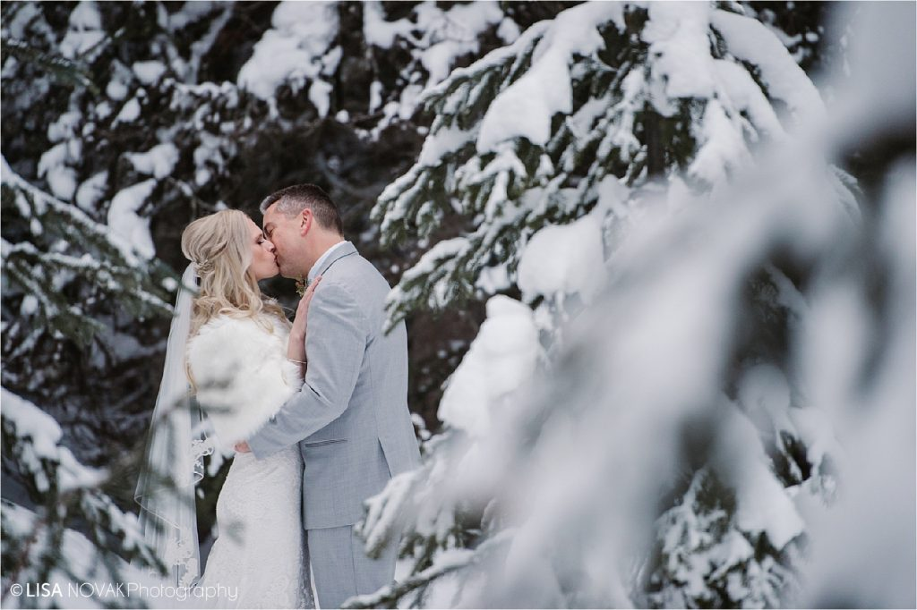 Romantic winter wedding in the forest.  Bridal portrait at Sun Peaks Resort by Kamloops photographer