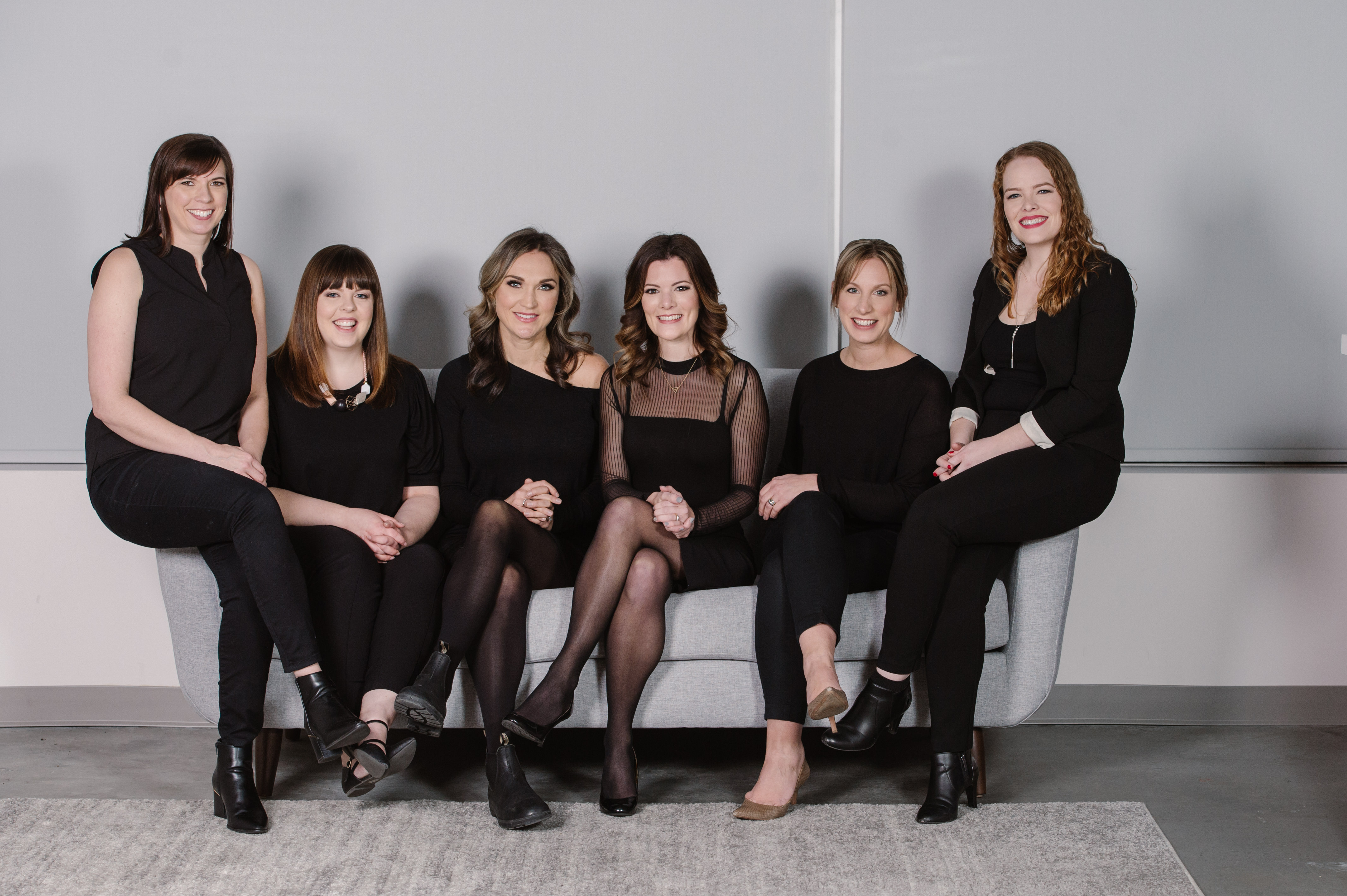 classic indoor corporate team photo on a couch of a group women Kamloops headshot photographer